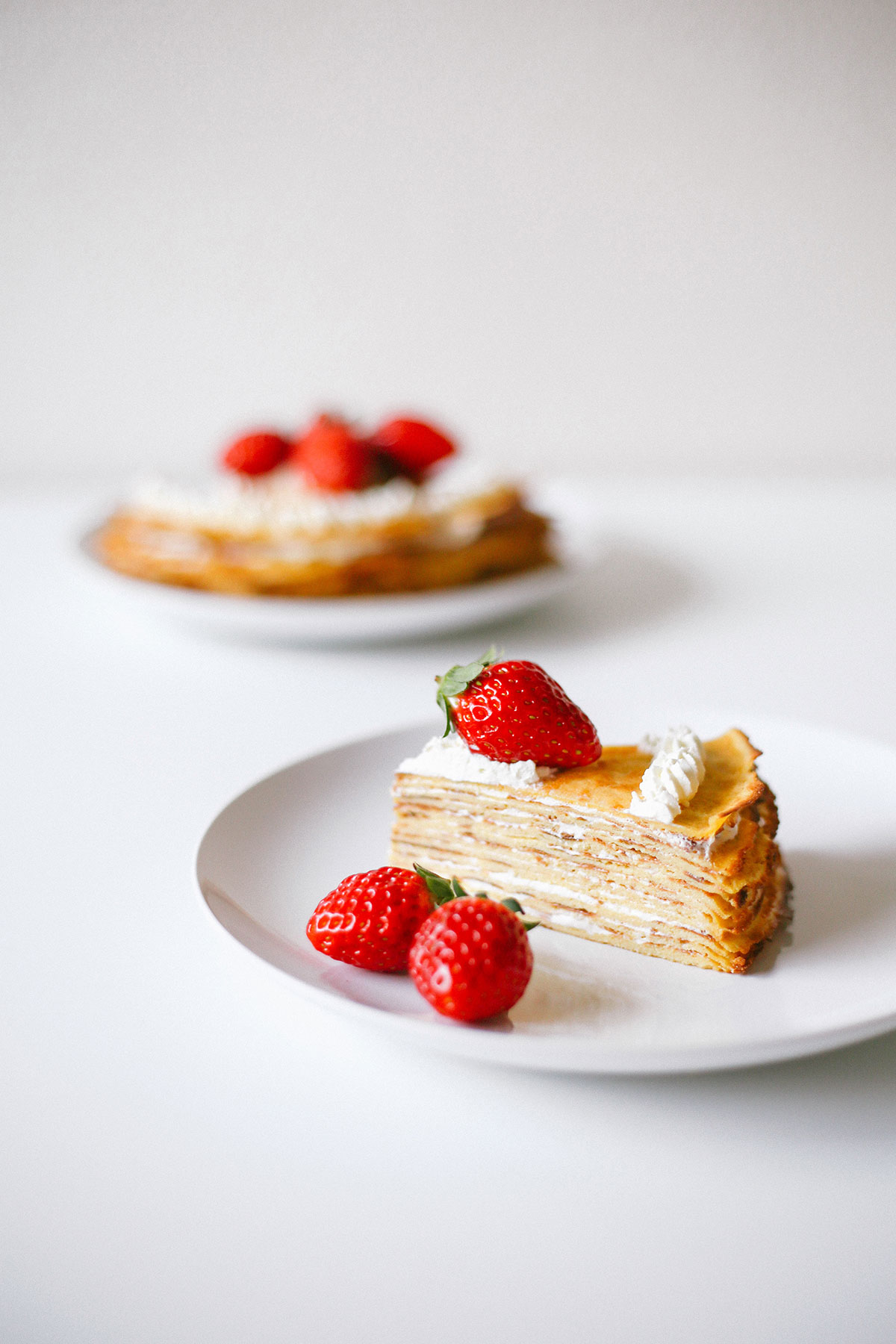 Keto crepe cake for low carb. Easy mille crepe recipe served with strawberries.